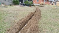 Downspout Routing and Bury water flow directed away from home storm drain Columbia MO Drainage by Jolly Lawncare