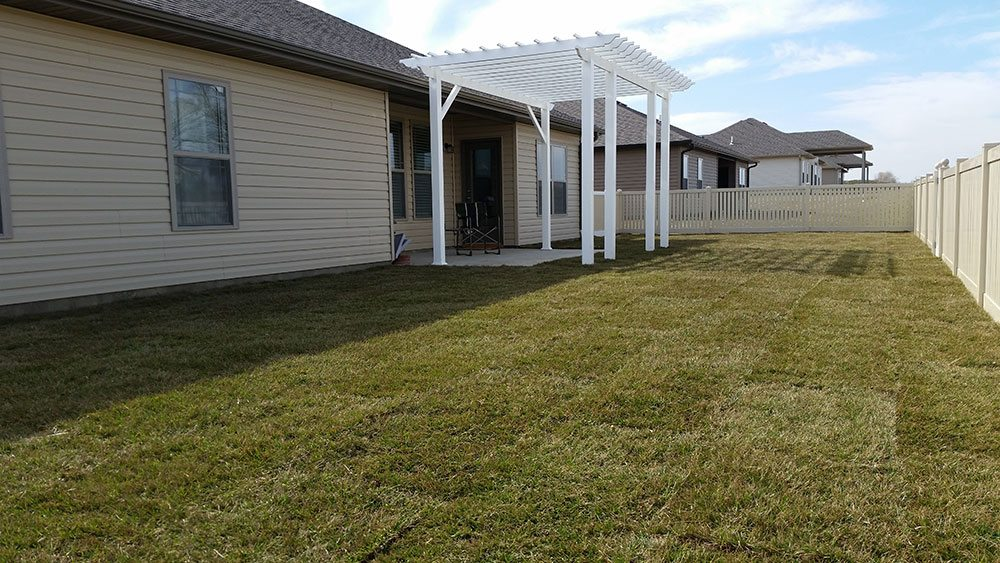 French Drain with Routed Downspouts and Soil Conditioning including Amending the Soil and Sodded with Fescue Jolly Lawncare and Lanscaing in Columbia Missouri 2