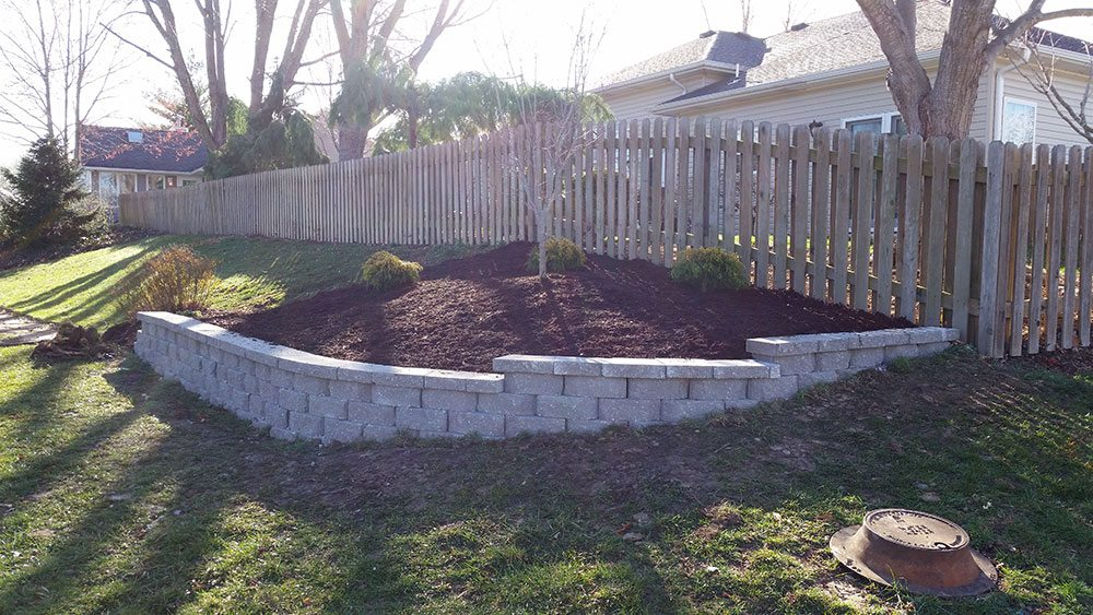 Retaining Wall Hillside Flower Bed by Jolly Lawncare in Columbia Missouri after
