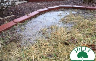 Standing Water against Home Foundation or Footing causes Cracks Leaks Settling Jolly Lawncare Landscaping in Columbia MO fixes with propper drainage french drain handling downspouts