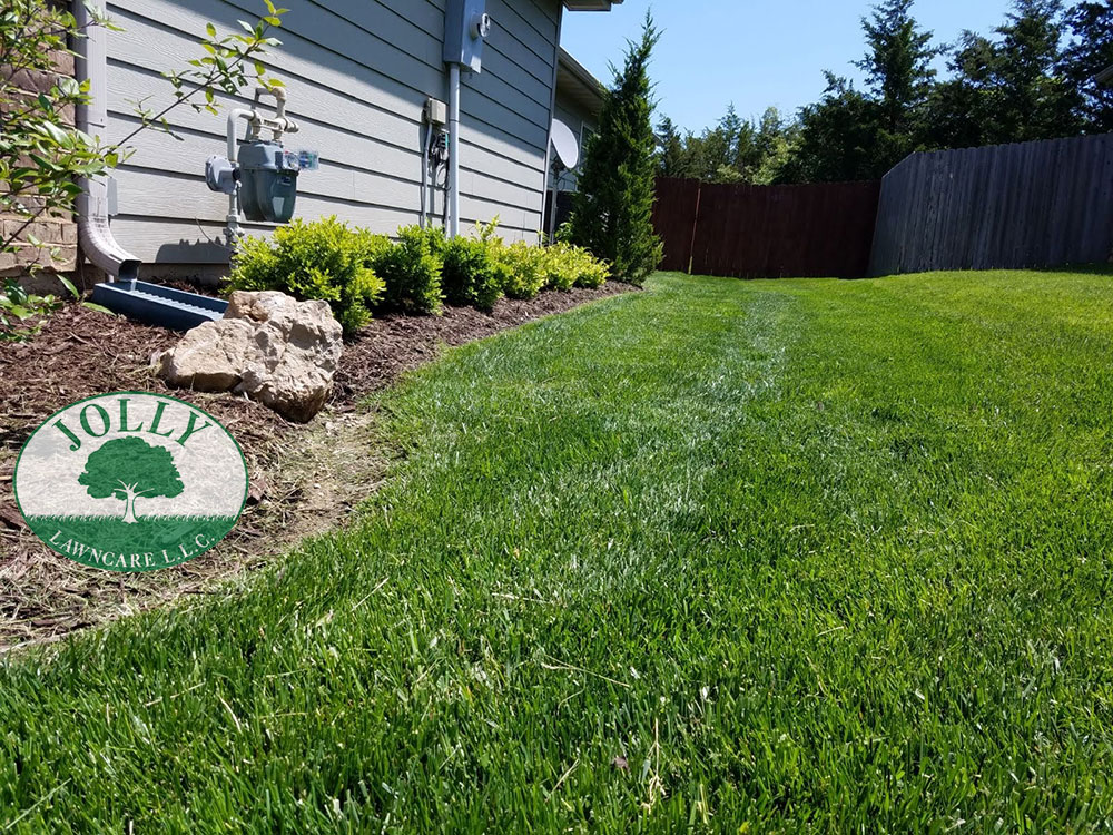 French Drain Removes Standing Water against your house Foundation and Footing to prevent Cracks and Leaks and Settling Jolly Lawncare Landscaping in Columbia MO web