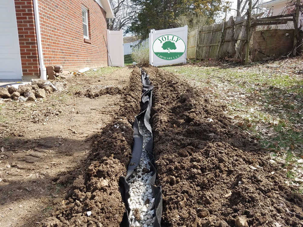 Standing Water against a Home Foundation or Footing causes Cracks Leaks and Settling Jolly Lawncare Landscaping in Columbia MO fixes with french drain handling downspouts 2