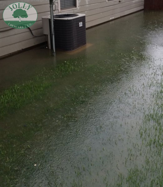 Standing Water against a Home Foundation or Footing causes Cracks Leaks and Settling Jolly Lawncare Landscaping in Columbia MO fixes with french drain handling downspouts web