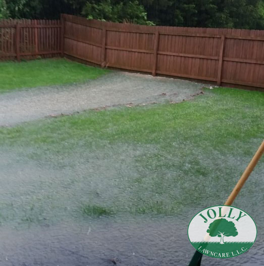 Standing Water against a Home Foundation or Footing causes Cracks Leaks and Settling Water Washing away a Fence Jolly Lawncare Landscaping in Columbia MO fixes with french drain handling downspouts web