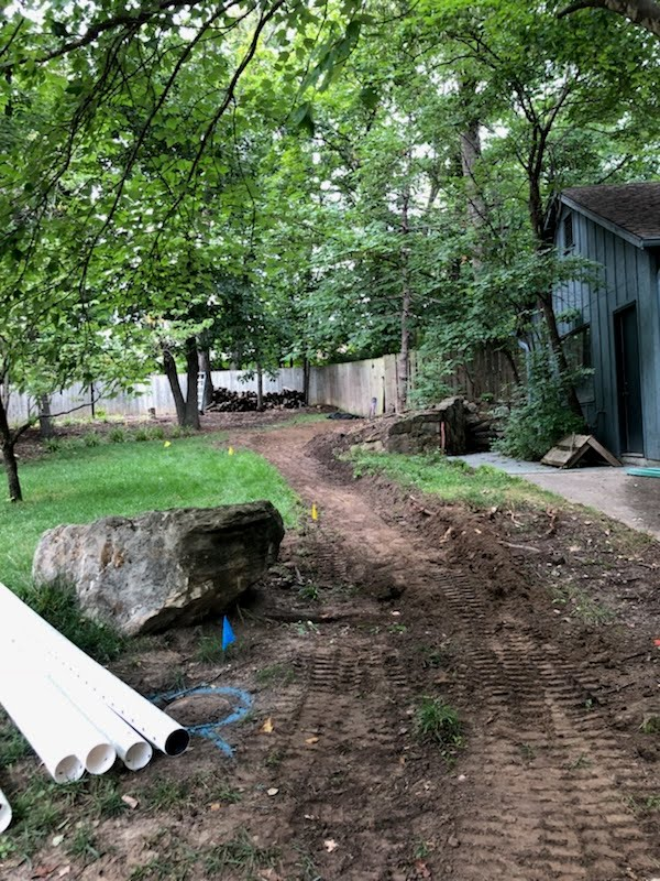 Dry Creek Bed Hardscape prevents Erosion. A French Drain Alternative which creates a Gravel Walkway 1 Jolly Lawncare and Landscaping In Columbia Missouri