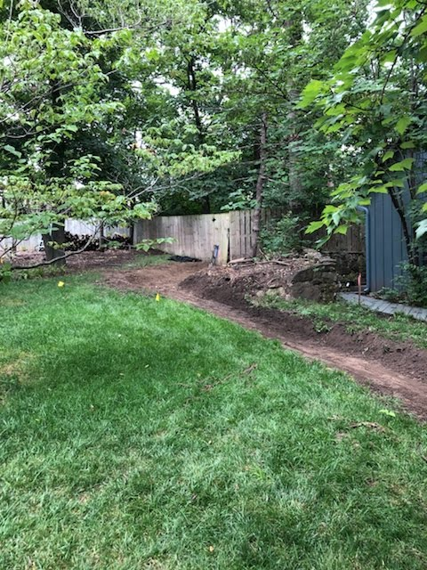 Dry Creek Bed Hardscaping helps prevent erosion. An Alternative to French Drains. Gravel Path by Jolly Lawncare and Landscaping In Columbia, MO
