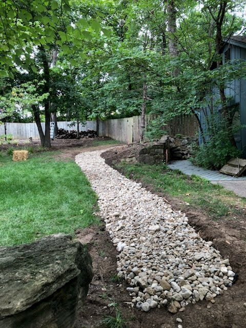Dry Creek Bed Install For Erosion Control. An Alternative to a French Drain. Also a Gravel Walkway by Jolly Lawncare and Landscaping In Columbia Missouri
